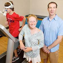Professor Charles Hillman and post-doctoral researcher Laura Chaddock-Heyman, and 10-year-old boy on treadmill